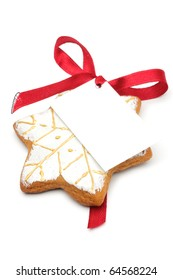 Illustrated Christmas cookies - a Asterisk. Decorated cookies as a gift. A red ribbon tied white cardboard card.Isolated on a white background.
