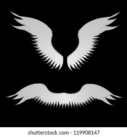 Illustration of abstract angel wings on black background.