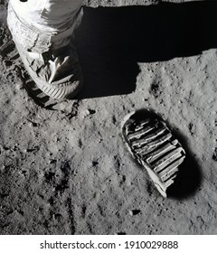 An illustration of Astronaut's boot print on moon (lunar) surface. Elements of this image furnished by NASA. - Shutterstock ID 1910029888