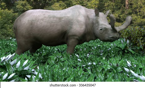 An illustration of a Brontotherium eating a buffet of vegetation. Brontotherium is an extinct group of large herbivores. It was endemic to North America during the Late Eocene epoch.