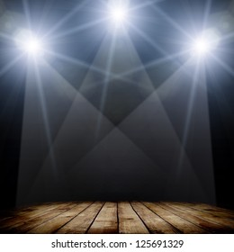 illustration of concert spot lighting over dark background and wood floor