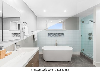 Illustration Drawing diagonal Split screen to Photograph of Luxury bathroom interior with an oval bathtub stone tiles and with glass shower.