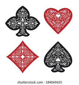 Illustration of four ornate card suits