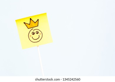 Illustration of a happy face of king smiling with a crowd on stick holder with blue background.