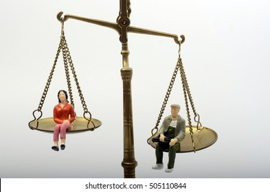 Illustration of inequality concept : man and women on a weighing balance, gender pay gap