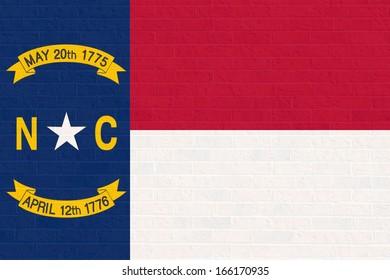 Illustration of North Calorina state flag on brick wall,United States of America.