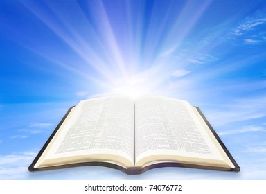 illustration of the opened Bible with sun rays