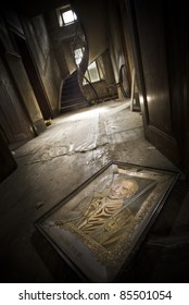 An illustration of a religious person laying broken on the floor at this creepy scenery.