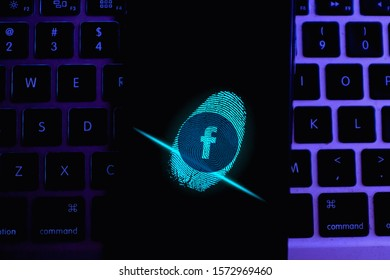 Illustration of security footprint and smart phone with FACEBOOK logo that is a popular social network. United States, California, Wednesday, November 27, 2020