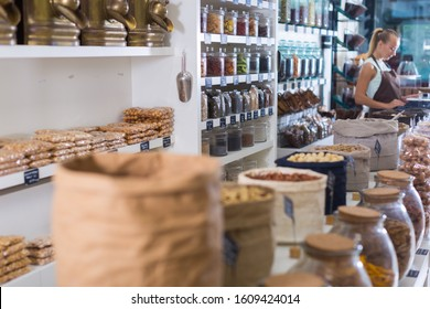 Illustration of showcase with dried fruits and nuts in bag in the shop.