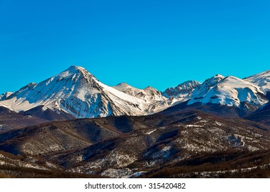 Illustration of a snowy mountain range as winter concept