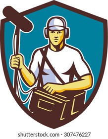 Illustration of a soundman film crew worker with headphone carrying bag holding a telescopic microphone facing front set inside shield crest on isolated background done in retro style.