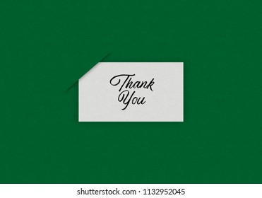 Illustration of White Card over green background written THANK YOU