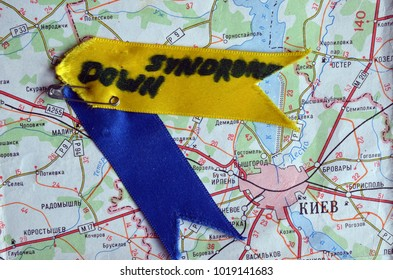 ILLUSTRATIVE EDITORIAL. Down syndrome  yellow blue ribbons symbol. Similar colors of ukrainian flag. Back - Map of Ukraine with location of capital. Kiev,Ukraine.February5, 2018