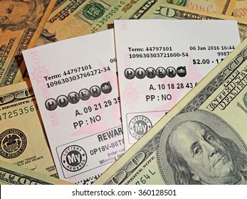 Illustrative Editorial - HAGERSTOWN, MD - JANUARY 9, 2016:  Image of Powerball lottery tickets on a US currency background.