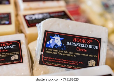 Illustrative editorial image of local Hook's Barneveld Blue Cheese goat cheese in a display case in Wisconsin.