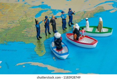 Illustrative editorial - Miniature people concept of Middle Eastern people arrive by boat to the border of USA.