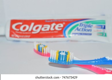 Illustrative Editorial: Norman, OK November 3, 2017 Colgate toothpaste and two toothbrushes on a white background