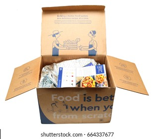 Illustrative editorial: Open box of meal prep ingredients in cooler bag with recipe cards on top. Blue Apron is a meal delivery service that provides weekly meal ingredients & recipes to subscribers.