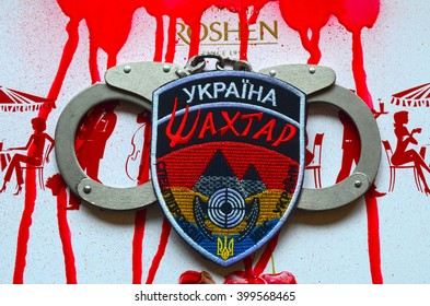 ILLUSTRATIVE EDITORIAL.Chevron of Ukrainian nazionalist battalion Miner in Police.The battalion disbanded for looting,rape and torture. With logo Roshen Inc. .At February 20,2016 in Kiev, Ukraine