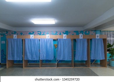 Illustrative image of the election in a democratic society. Elections in Ukraine. The process of voting at a polling station. Empty voting booths at a polling station.