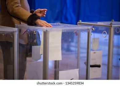 Illustrative image of the election in a democratic society. Elections in Ukraine. The process of voting at a polling station. The voter throws the ballots in the ballot box.