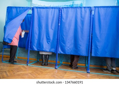 Illustrative image of the election in a democratic society. Elections in Ukraine. The process of voting at a polling station. Voters vote in polling booths.