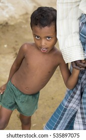 Illustrative image. Pondicherry, Tamil Nadu, India - April 21, 2014. Poor child with sad feeling, in the street.
