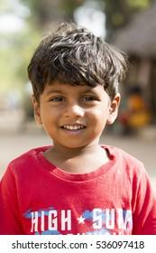 Illustrative image. Pondicherry, Tamil Nadu, India - Marsh 07, 2014. Poor child with smile feeling, in the street