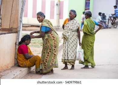 Illustrative image. Pondicherry, Tamil Nadu, India - April 21, 2014. Scenes of life in small poor villages, way of life, poverty for many woman, man, children