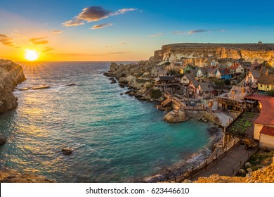 Il-Mellieha, Malta - Panoramic view of the famous Popeye Village at Anchor Bay at sunset