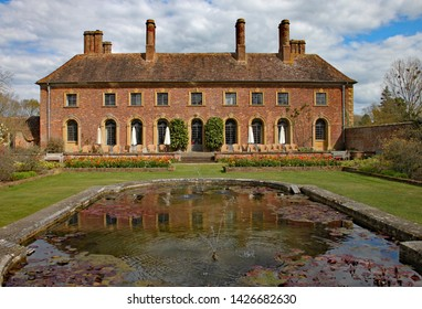 ILMINSTER, SOMERSET, ENGLAND - APRIL 15TH 2012: An English stately home sits behind an ornamental pond