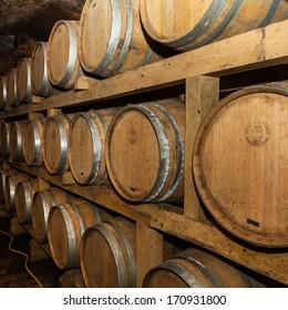 ILOK, CROATIA - MAY 4, 2012: Old wine cellar in Ilok, Croatia, with old oak barrels on display; a must see tourist attraction in Baranja region of Croatia.