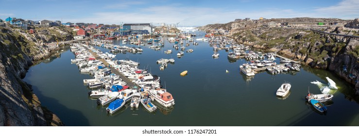 Ilulissat, Greenland - July 03, 2018: Panoramic view of the harbor in Ilulissat