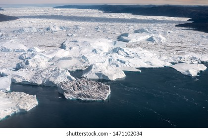 Ilulissat, Greenland - July 2, 2019: Aerial view of the Ilulissat ice fjord with endless ice bergs. The ice fjord in western Greenland is a Unesco world heritage site.