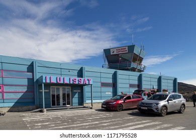 Ilulissat, Greenland - June 30, 2018: Taxis and people waiting outside the airport building