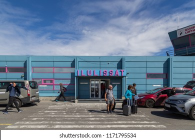 Ilulissat, Greenland - June 30, 2018: People leaving the blue airport building