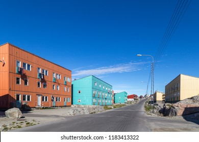 Ilulissat, Greenland - June 30, 2018: Street with coloful wooden houses in the city