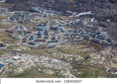 Ilulissat, Greenland - June 30, 2018: Aerial view of coloful wooden houses in a residential area