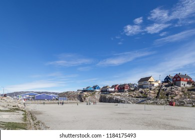 Ilulissat, Greenland - June 30, 2018: People playing soccer on the soccer field