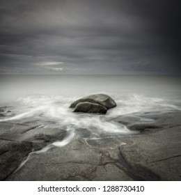 i was im the Bajau Bay, Singkawang, West Kalimantan, Indonesia. im going to ahot a sunset but it seems like the light is not good. so i decided to shot this rock and turn it into minimalism photograph