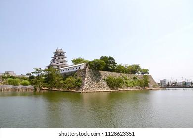 Imabari, Ehime, Shikoku /Japan - Aug. 7, 2016: Imabari castle keep and the reflection on its fosse.