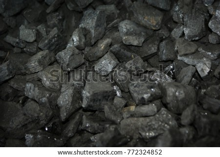 Imag of coal with shallow focus to highlight center of image and produce useful blurs at top and bottom for the addition of text etc.