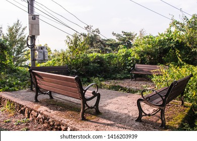 The image of 2 pairs of benches which facing each other in mountain.