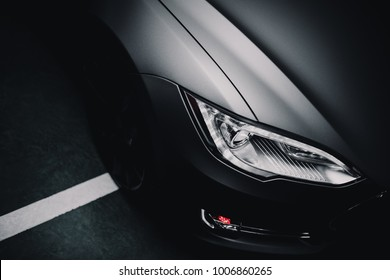 Modern car wrapped in grey color matte vinyl
