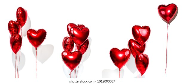 Set of Air Balloons. Bunch of red color heart shaped foil balloons isolated on white background. Love. Holiday celebration. Valentine's Day party decoration. Metallic red colour Heart air ballons