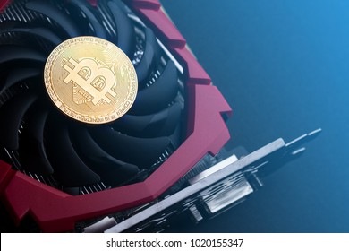 cryptocurrency mining concept with one golden bitcoin on top of a computer performant video card black fan