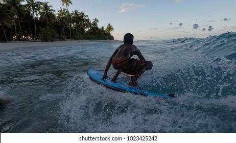 Grom surfing on a soft top at Fuvahmulah, Maldives