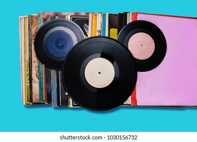 Top view of vinyl records isolated on the blue stylized to Mickey Mouse. USSR concept