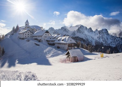 Panoramic view of small ancient village on the top of Monte Lussari in Tarvisio. Julian Alps, Italy.